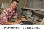 handsome male carpenter smiling ... | Shutterstock . vector #1250612488