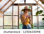 gardener using her phone in the ... | Shutterstock . vector #1250633098