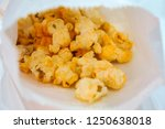 cheese flavour popcorn | Shutterstock . vector #1250638018