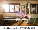 peak pilates   young woman... | Shutterstock . vector #1250687578