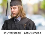 young handsome graduated man... | Shutterstock . vector #1250789065