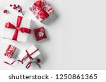 christmas gift boxes with red... | Shutterstock . vector #1250861365