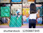Stock photo child girl watching friends play at the playground 1250887345