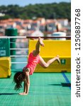 girl doing cartwheels on...   Shutterstock . vector #1250887768