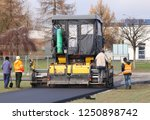 laying asphalt with the help of ... | Shutterstock . vector #1250898742