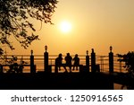 silhouette at the sunset or... | Shutterstock . vector #1250916565