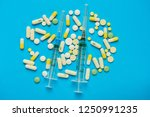 syringes and many pills on a... | Shutterstock . vector #1250991235