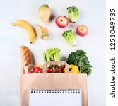 paper bag and different healthy ... | Shutterstock . vector #1251049735