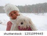 girl in the park in the winter  ...   Shutterstock . vector #1251099445