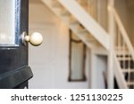 open front door close up to new ... | Shutterstock . vector #1251130225