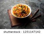 schezwan noodles or vegetable... | Shutterstock . vector #1251147142