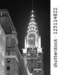 Small photo of NEW YORK CITY, NY, USA - DEC 30: Chrysler Building at night with street on December 30, 2011, New York City. It was designed by architect William Van Alena as Art Deco architecture in US.
