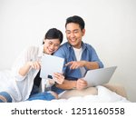 happy asian couple lover using... | Shutterstock . vector #1251160558