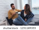 young couple in love embracing... | Shutterstock . vector #1251189355