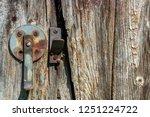 a rusty round swing latch is... | Shutterstock . vector #1251224722