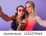 fitness girls send air kiss and ... | Shutterstock . vector #1251279565