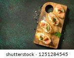antipasti snacks for wine.... | Shutterstock . vector #1251284545