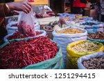 a shopper buying spicy yunnan...   Shutterstock . vector #1251294415