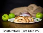 sweet homemade strudel with... | Shutterstock . vector #1251334192