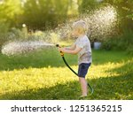 funny little boy playing with... | Shutterstock . vector #1251365215