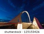 REGGIO EMILIA, ITALY - SEPTEMBER 25: famous bridges complex by architect Santiago Calatrava in Reggio Emilia on September 25, 2012. The central arch of the bridge is 220 meters long and 50 meters high - stock photo