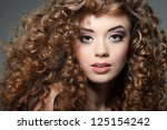 young beautiful woman with long ... | Shutterstock . vector #125154242