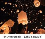 launching floating lanterns... | Shutterstock . vector #1251550315