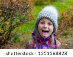 girl posing with a cute face ... | Shutterstock . vector #1251568828