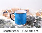 blue mug with hot  tea  coffee... | Shutterstock . vector #1251581575