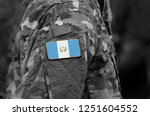 flag of guatemala on soldier... | Shutterstock . vector #1251604552