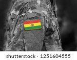 flag of bolivia on soldiers arm.... | Shutterstock . vector #1251604555