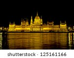 View of the Hungarian Parliament and its refflection on the Danube at night, Budapest, Hungary - stock photo
