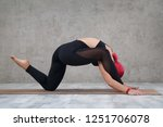 a girl with pink hair does yoga ... | Shutterstock . vector #1251706078