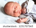 new born baby sleeping smiling... | Shutterstock . vector #1251707365