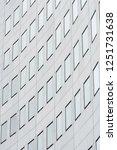 facade of a skyscraper in the... | Shutterstock . vector #1251731638