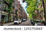 beautiful amsterdam street in... | Shutterstock . vector #1251753865
