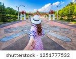women tourists holding man's... | Shutterstock . vector #1251777532