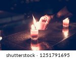 candle in her hands  a... | Shutterstock . vector #1251791695