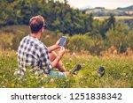 man using cellphone in nature... | Shutterstock . vector #1251838342