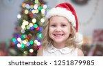 little girl in santa hat... | Shutterstock . vector #1251879985