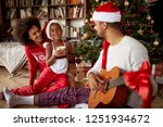 happy family sitting on floor... | Shutterstock . vector #1251934672