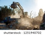 the excavator loads the remains ... | Shutterstock . vector #1251940702