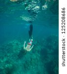 young man free diving and... | Shutterstock . vector #125208686