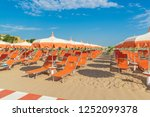 umbrellas and chaise lounges on ... | Shutterstock . vector #1252099378