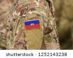 flag of haiti on soldier arm.... | Shutterstock . vector #1252143238