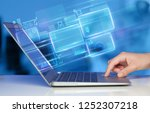 hand using laptop with database ... | Shutterstock . vector #1252307218