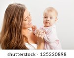 happy young mother  holding her ... | Shutterstock . vector #125230898