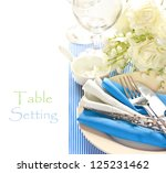 Blue and white romantic table setting. - stock photo