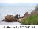 lonely man on the black sea... | Shutterstock . vector #1252485148