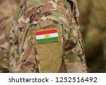 flag of kurdistan on soldiers... | Shutterstock . vector #1252516492